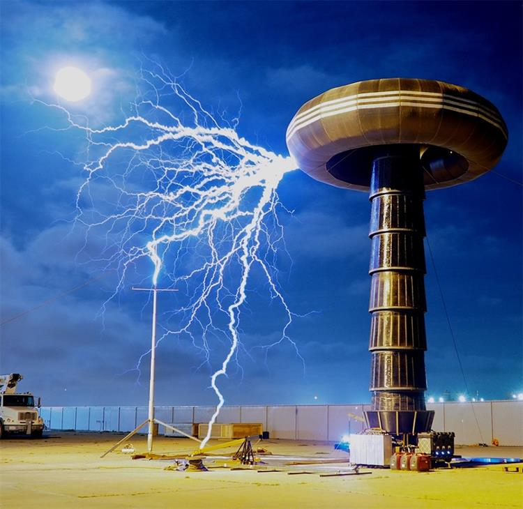 Museum of Discovery- a massive tesla coil sends bolts of electricity arcing across the sky before connecting to a ground terminal