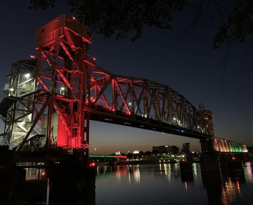 Little Rock's signature bridges lit gold, green and red for Juneteenth.