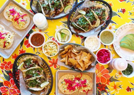 Latin-American food on a brightly colored table cloth.